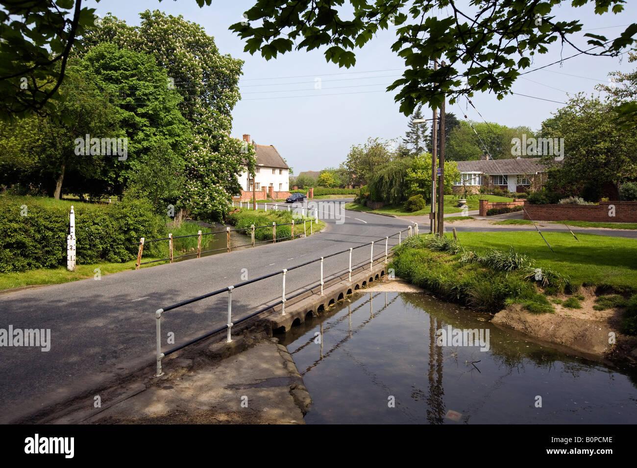 UK England Lincolnshire Bottesford road crossing River Devon near Flemings Hospital almshouses - Stock Image