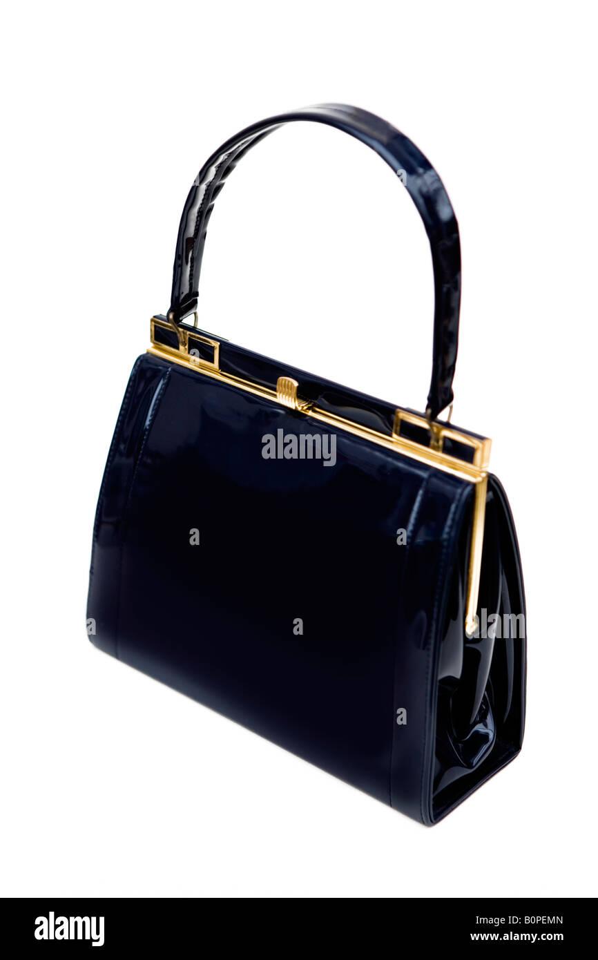 1950's/60's vintage black patent leather handbag - shot against a white background - Stock Image