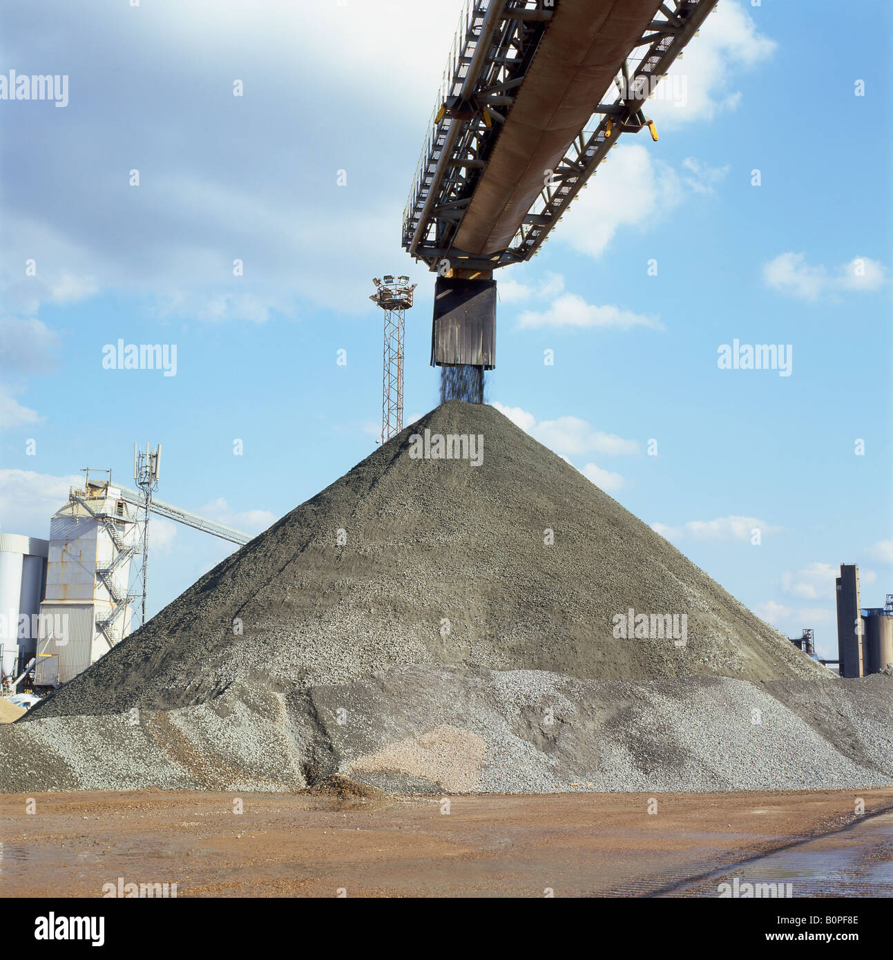 Pile of stones or duff being unloaded from a ship at Greenwich Docks, London, England UK - Stock Image