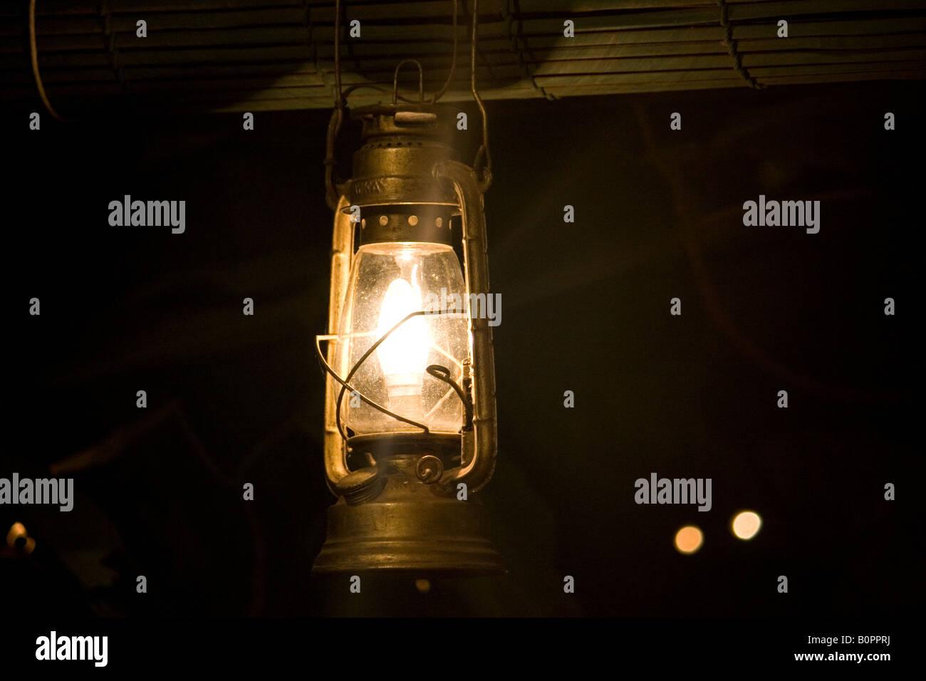 Hurricane lamp lit - Stock Image