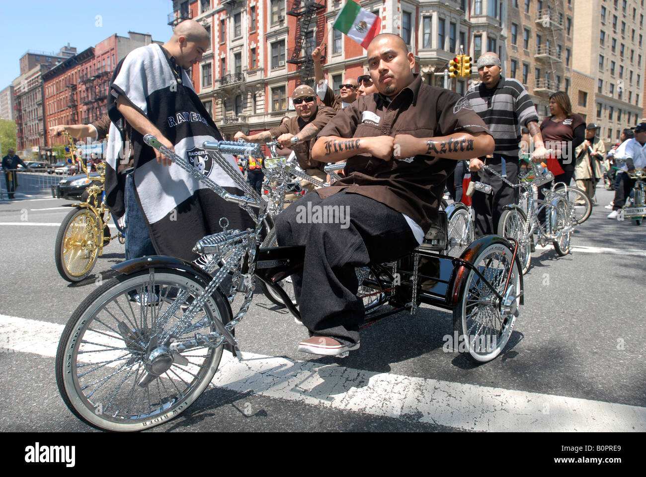 Members of the Firme Ridaz a novelty bicycle club ride in the Cinco de Mayo Parade in New York - Stock Image