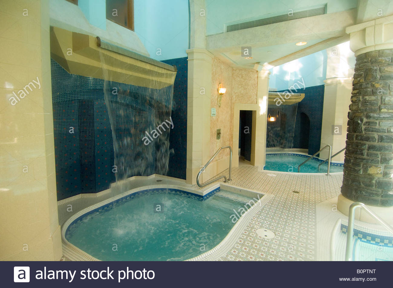 Whirlpool with waterfall at the Willow Stream Spa Fairmont Banff ...