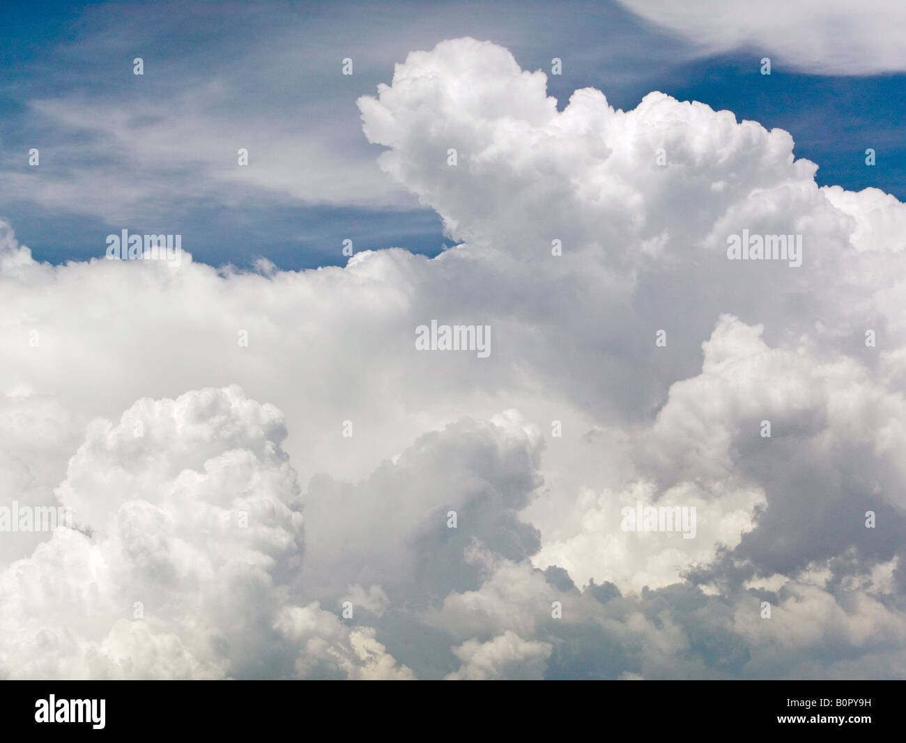 aerial above cumulus cumulonimbus cloud tops - Stock Image