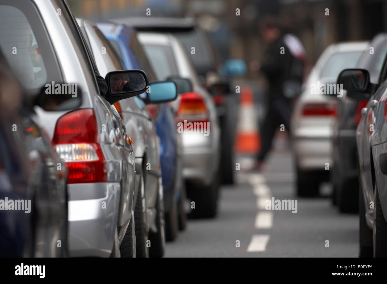 drivers sitting bored in their cars during traffic jam gridlock in belfast city centre - Stock Image