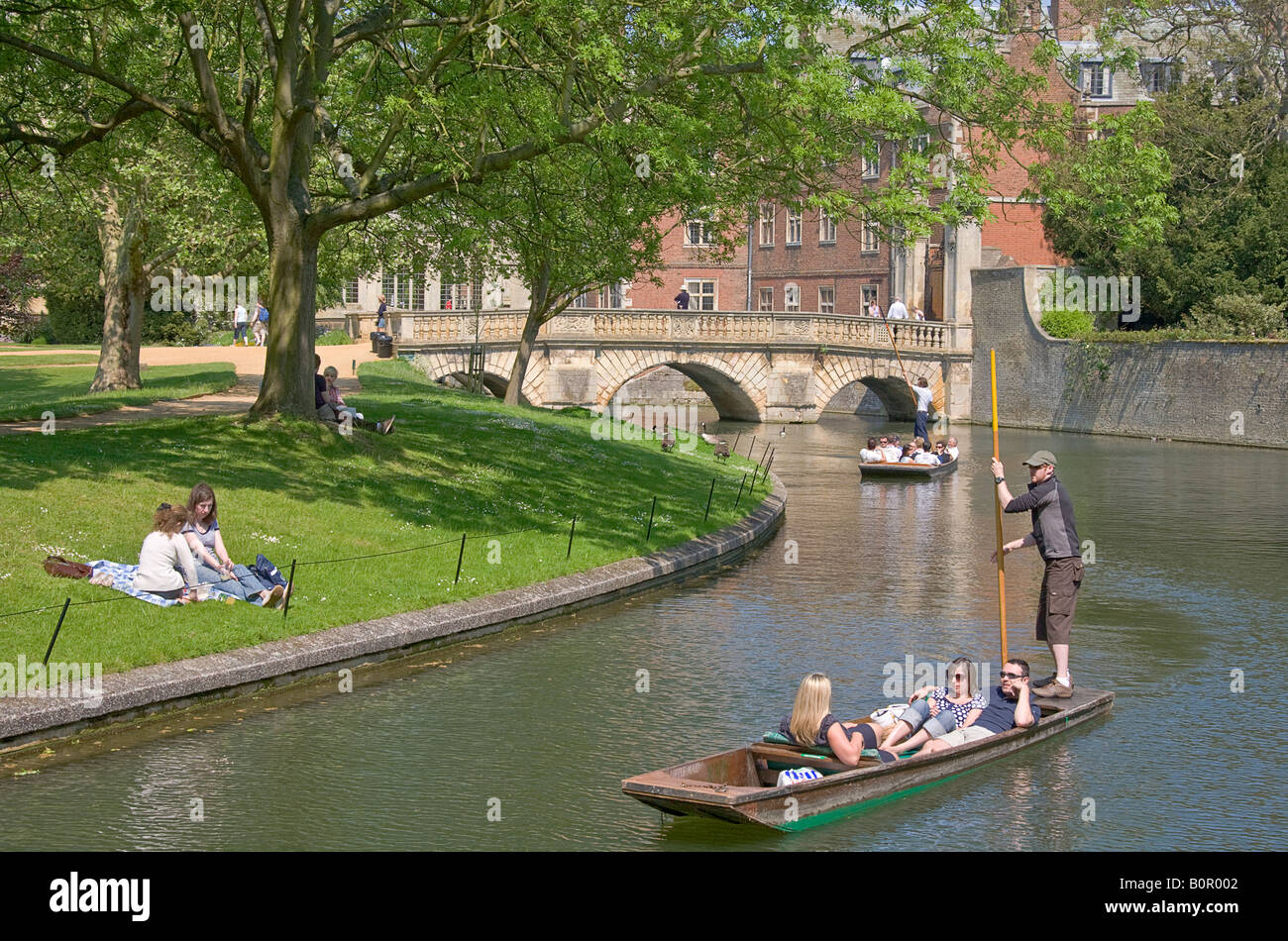 River Cam on a sunny day with punts, St Johns old bridge in background - Stock Image