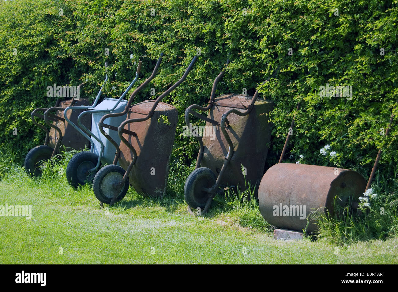 A line of wheelbarrows - Stock Image
