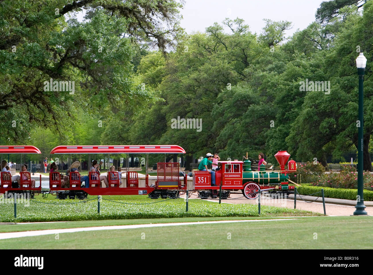 Small train gives visitors a tour of Hermann Park in Houston Texas - Stock Image