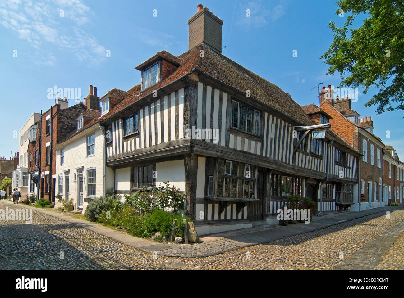 Horizontal wide angle of the beautiful Tudor cottages in Church Square in Rye on a sunny day. Stock Photo