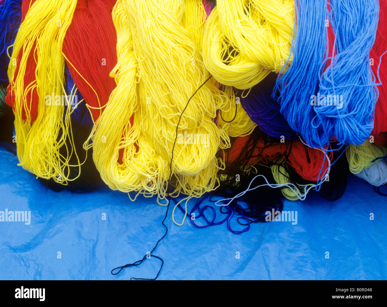 dyed threads of wool at market city of cuzco peru - Stock Image