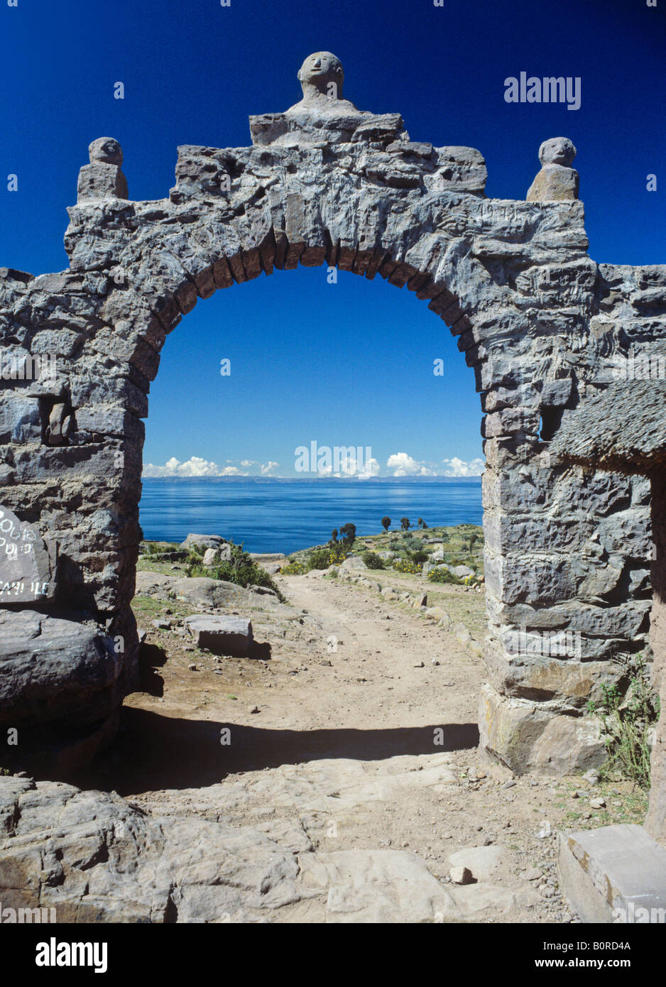view from stone arch gate to lake titicaca island of taquile peru - Stock Image