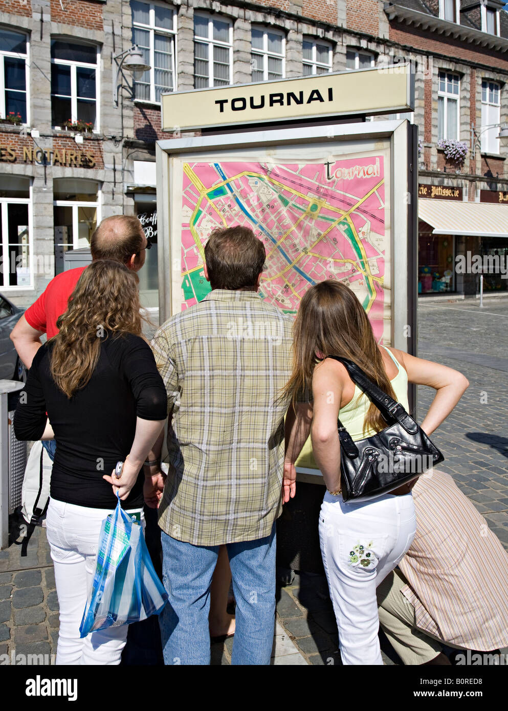 People gathered around town map Tournai Belgium - Stock Image