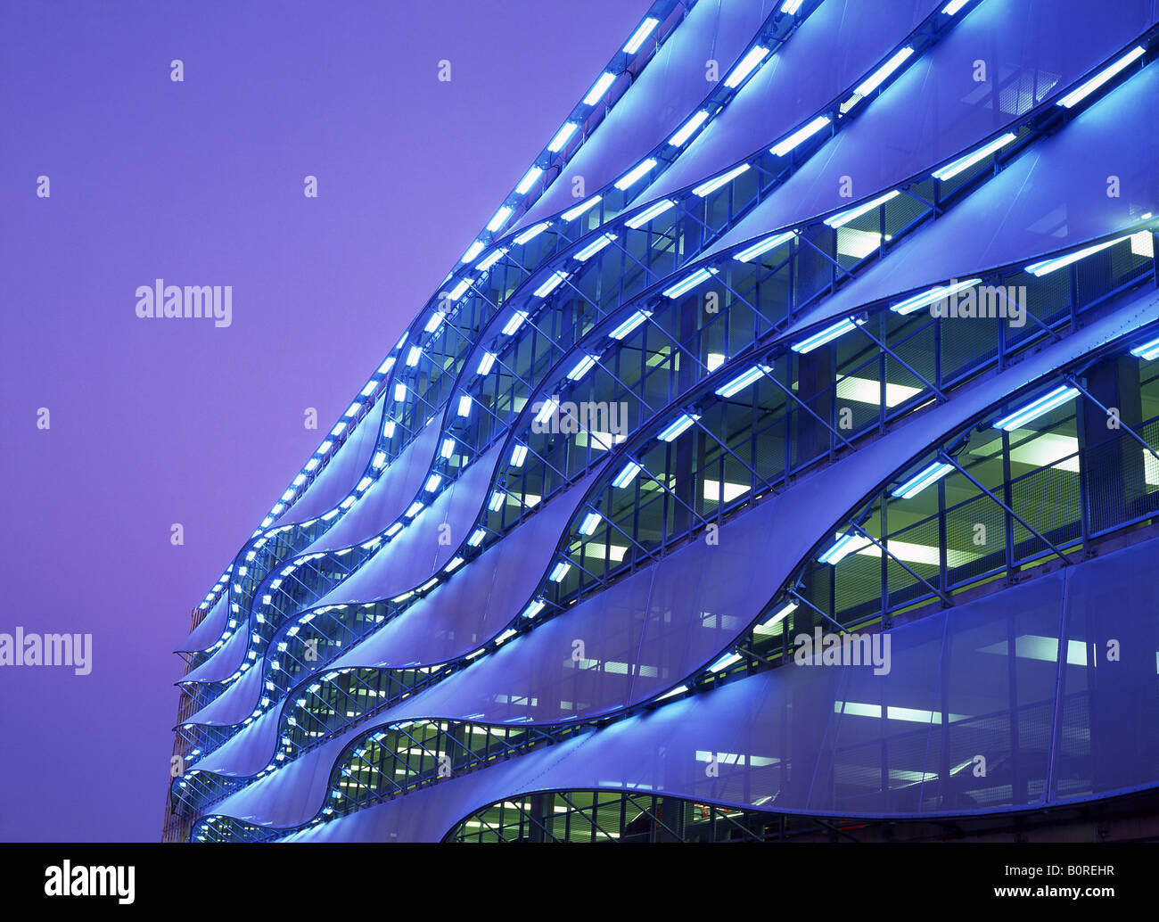 Exterior of multi-storey car park at night Cardiff Bay Cardiff South Wales UK - Stock Image