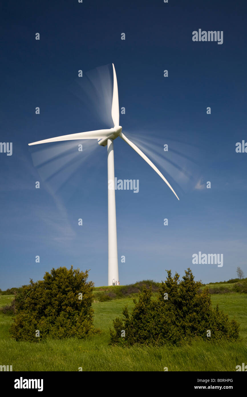 A windmill at work on the 'du Coiron' plateau (Ardeche - France). Eolienne en mouvement sur le plateau du - Stock Image