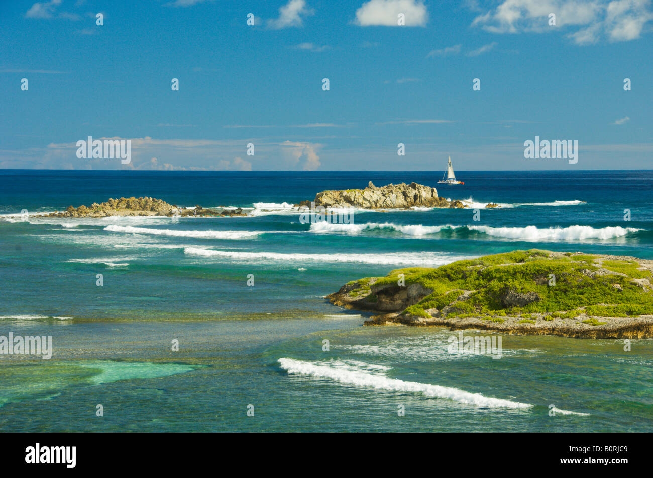 Small islands an shallow waters along the eastern coast of Saint Martin French Protectorate - Stock Image