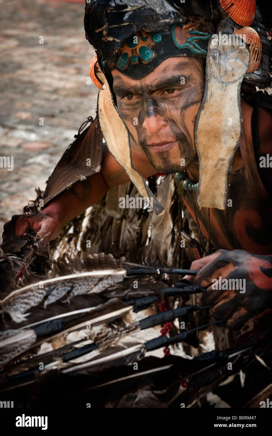 Street artist dressed as Mayan Indian Playa del Carmen Mexico - Stock Image