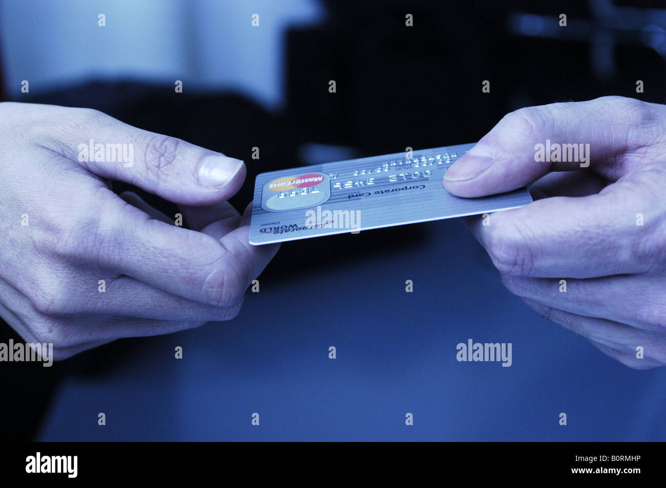 Businessmen paying with credit card - Stock Image