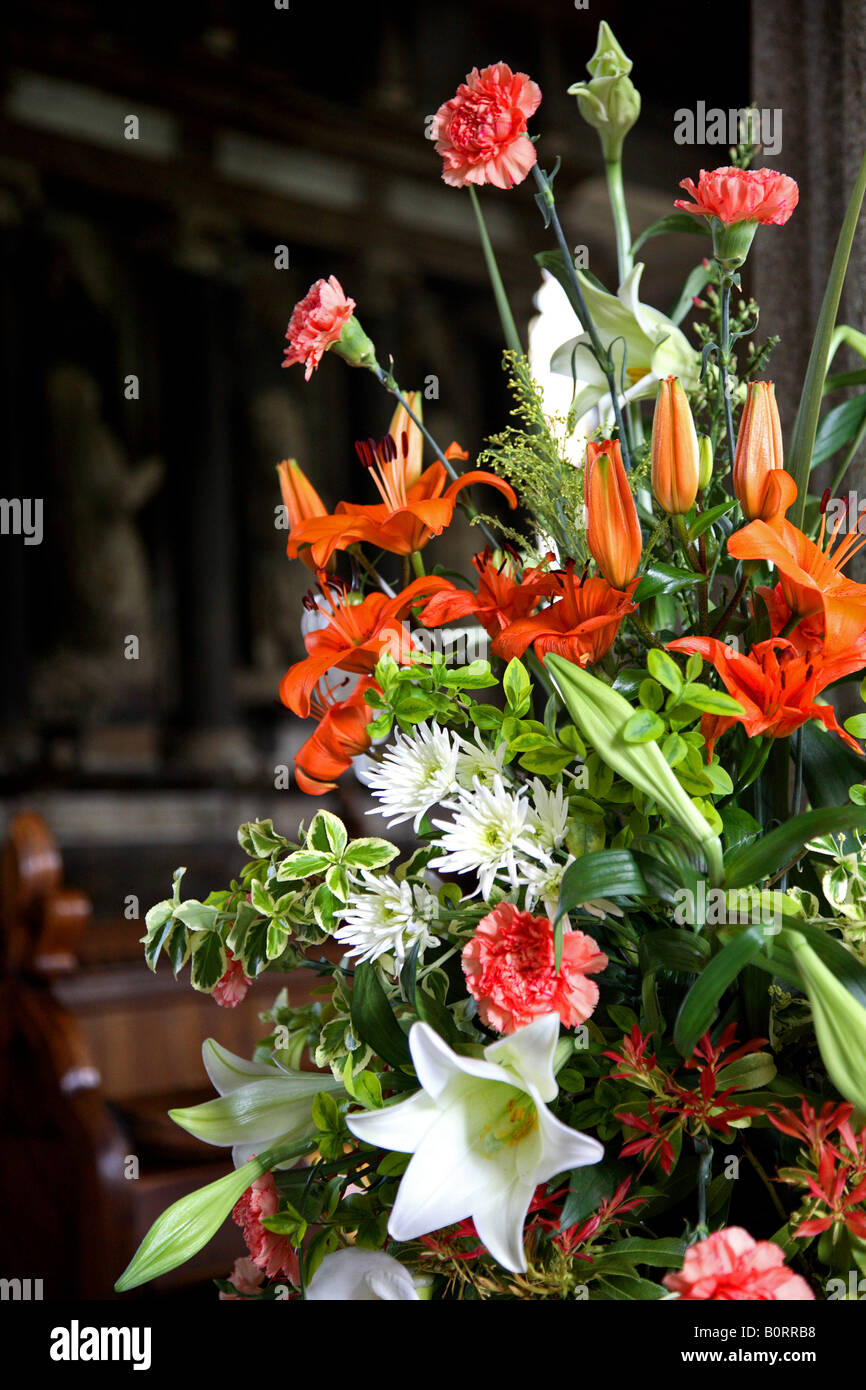 Wedding Flowers In Church Orange And White Lilies Stock Photo