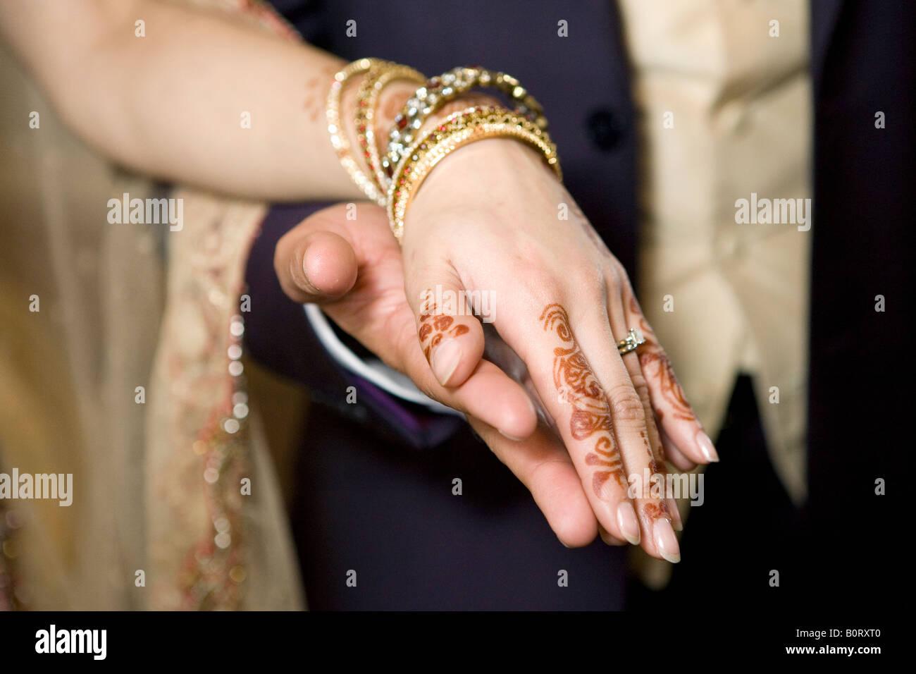 c027615e0b339 Indian wedding - holding hands with henna bridal mehndi Stock Photo ...