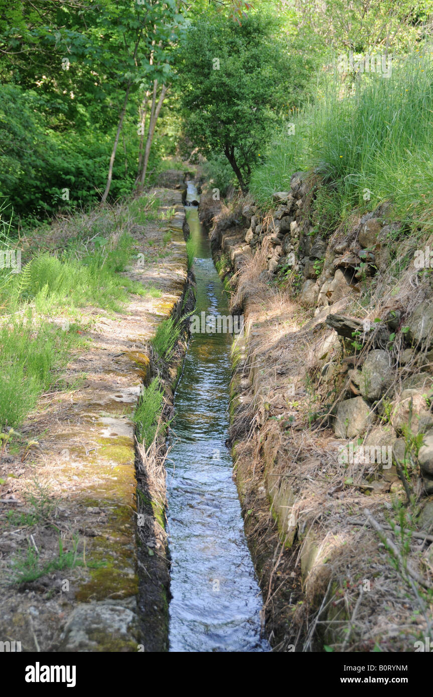 A béal, a man-made water irrigation channel, near Génolhac, Gard, France. - Stock Image