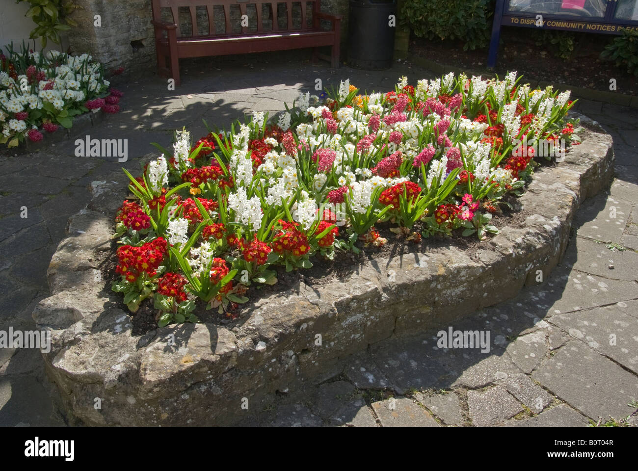 Narrow Raised Bed Of Spring Flowers In A Small Public Rest Area In