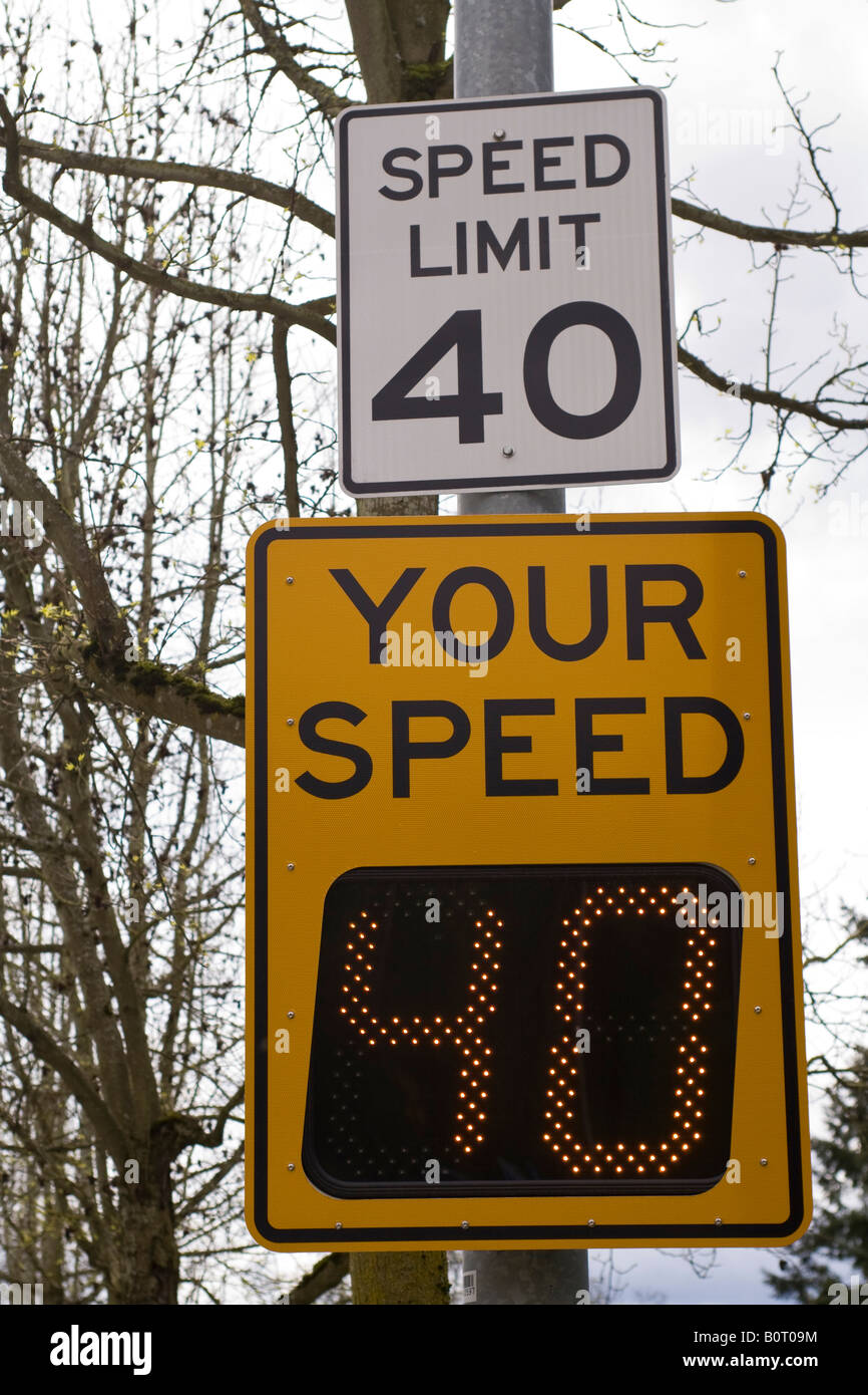 Electronic speed limit sign shows driver's speed. - Stock Image