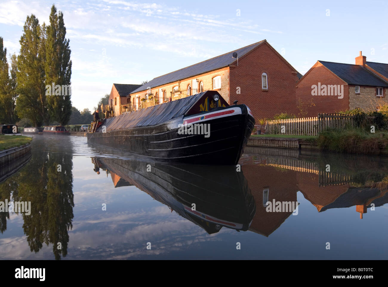 Doug Blane Traditional working narrowboat navigating at Cosgrove on the Grand Union Canal - Stock Image