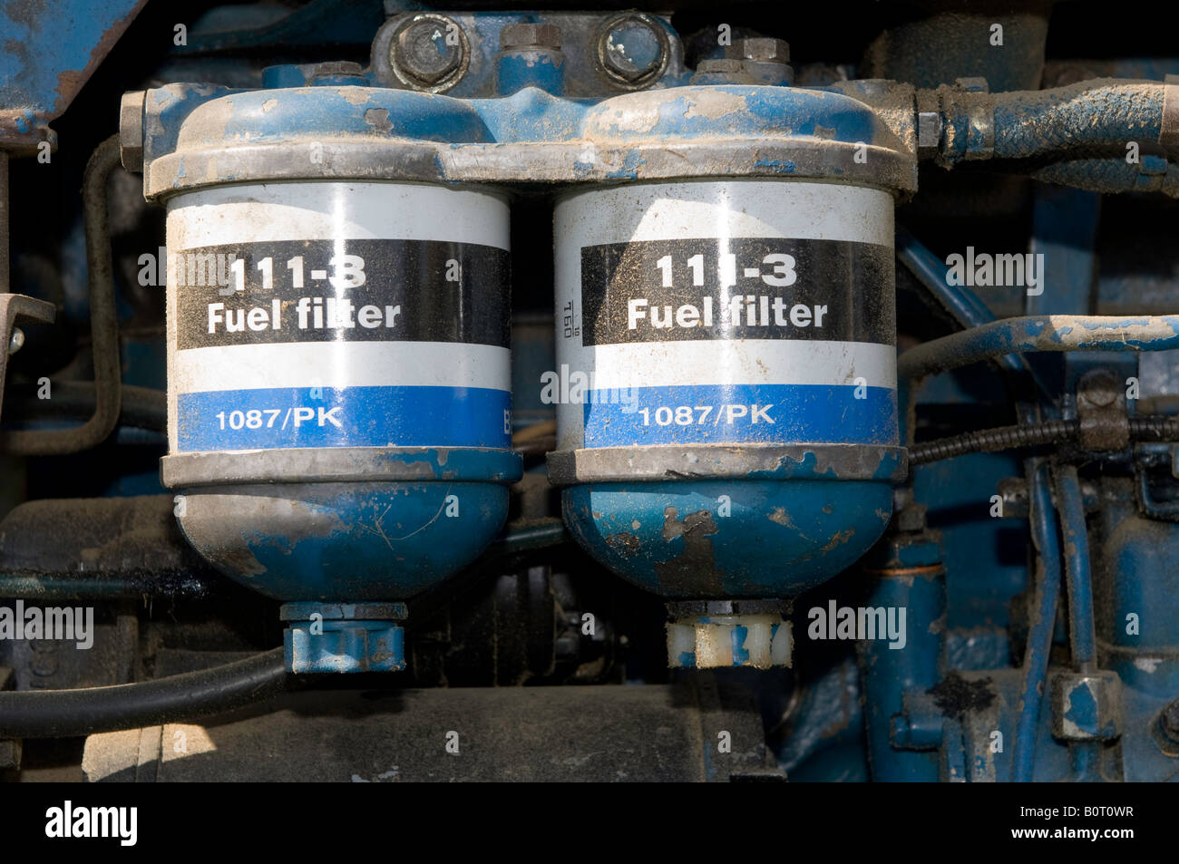 Fuel filters on a Ford 4400 tractor - Stock Image