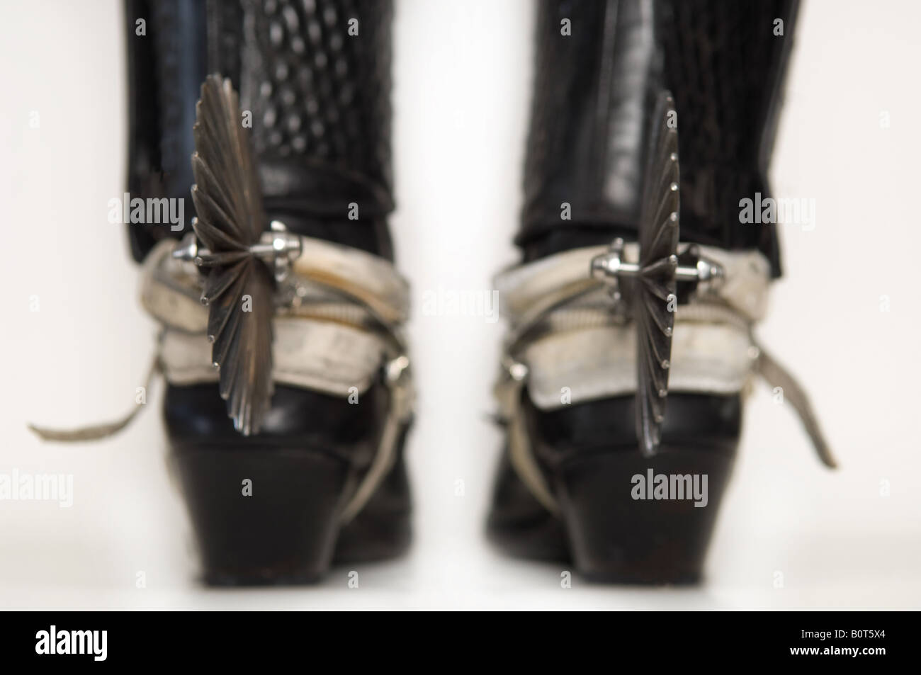Cowboy wearing boots with spurs, low section - Stock Image