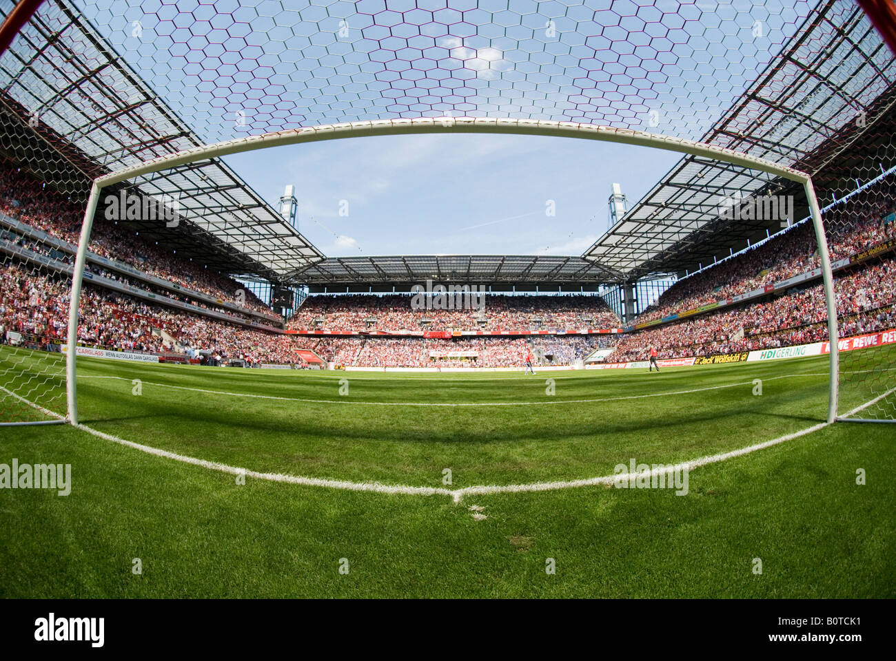 empty goal in filled football Stadium before kick-off - Stock Image