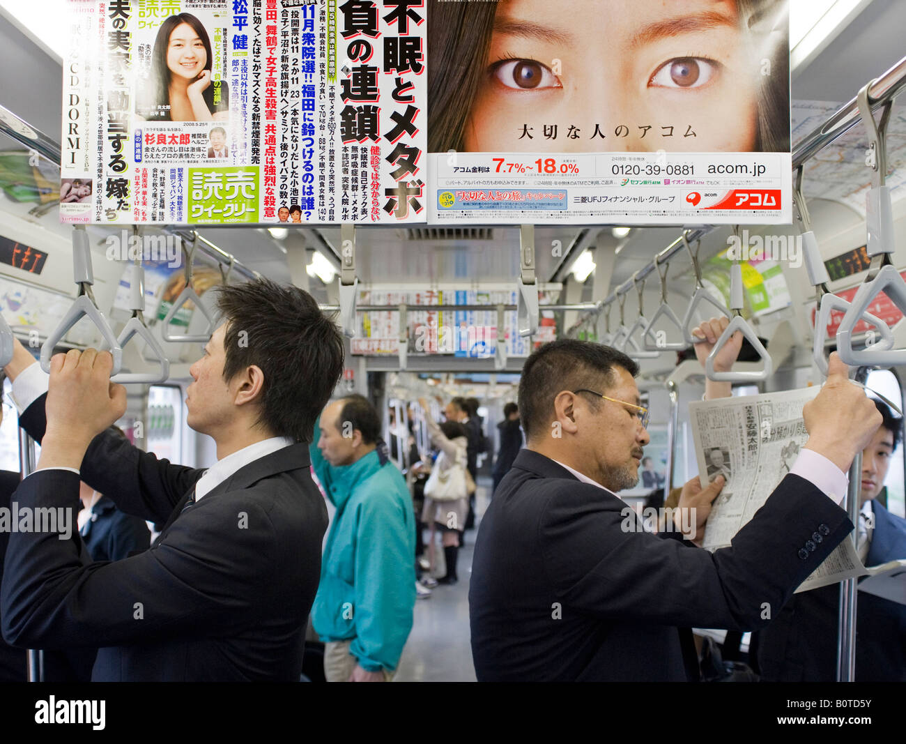 Advertising poster in carriage on railway train in Tokyo Japan - Stock Image