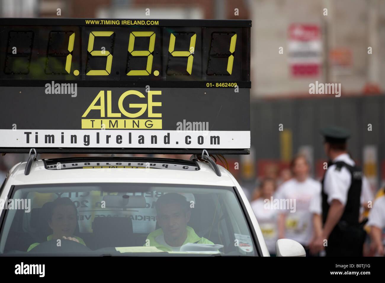 lead pace car showing marathon timing board during belfast city marathon 2008 1 . 59 . 36 - Stock Image