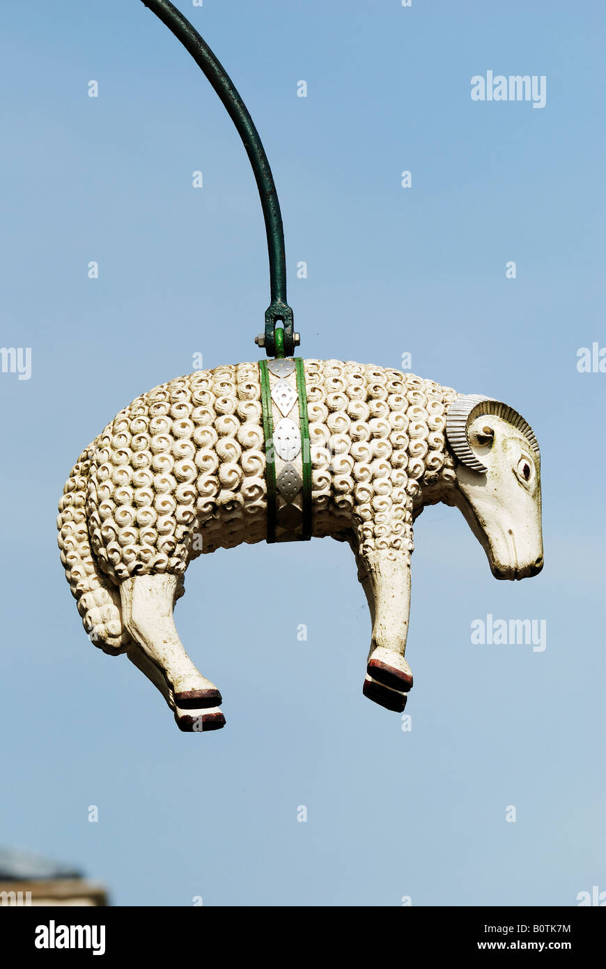 SIGN OF RAM HANGING OUTSIDE TRADITIONAL BUTCHER SHOP IN LLANIDLOES POWYS WALES - Stock Image
