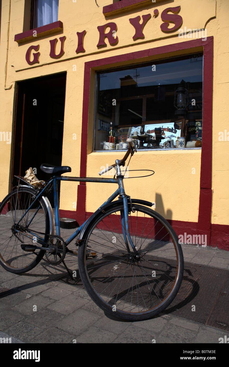 bicycle parked outside guirys irish pub in foxford a traditional small irish town in county mayo republic of ireland - Stock Image