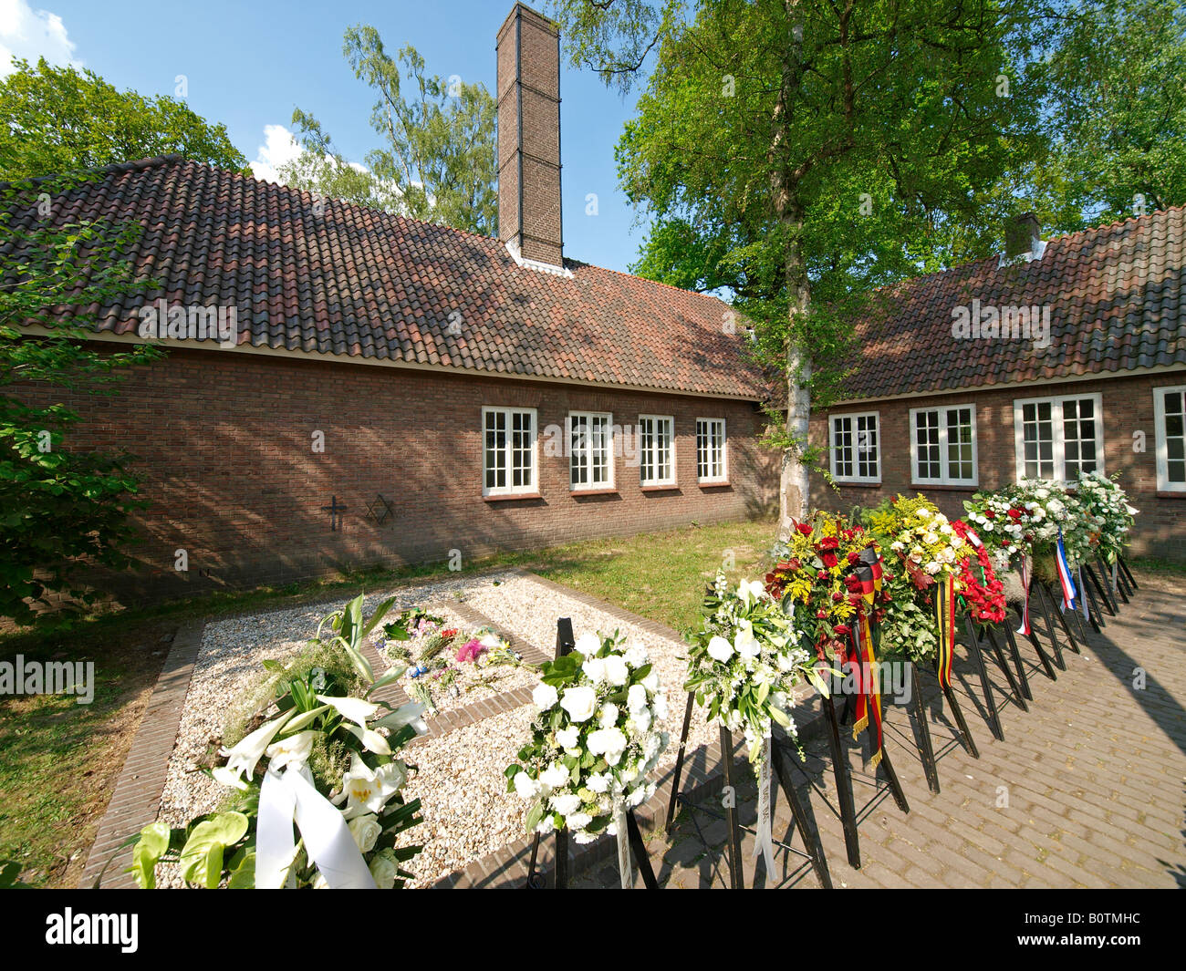Flowers of the yearly memorial service for the WW2 deaths at national monument concentration camp Vught the Netherlands - Stock Image