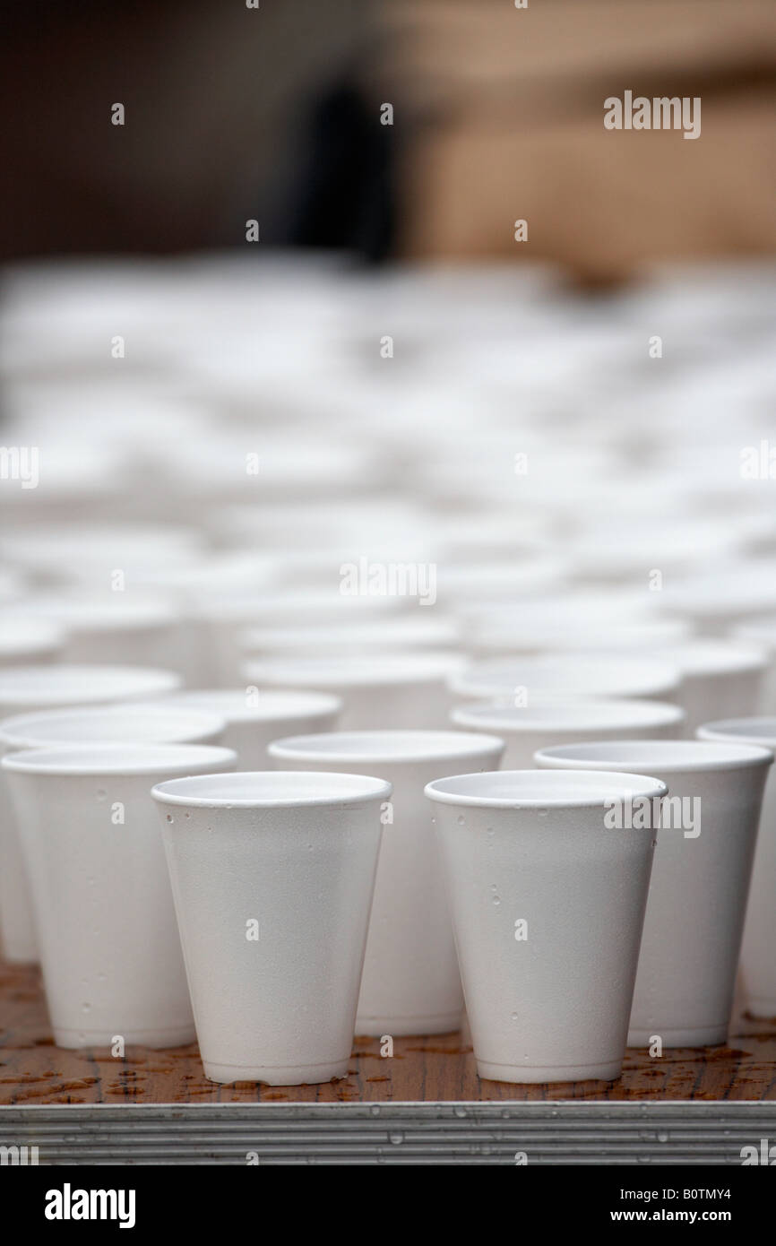 polystyrene styrofoam cups full of water sitting on a table during a marathon sports race - Stock Image