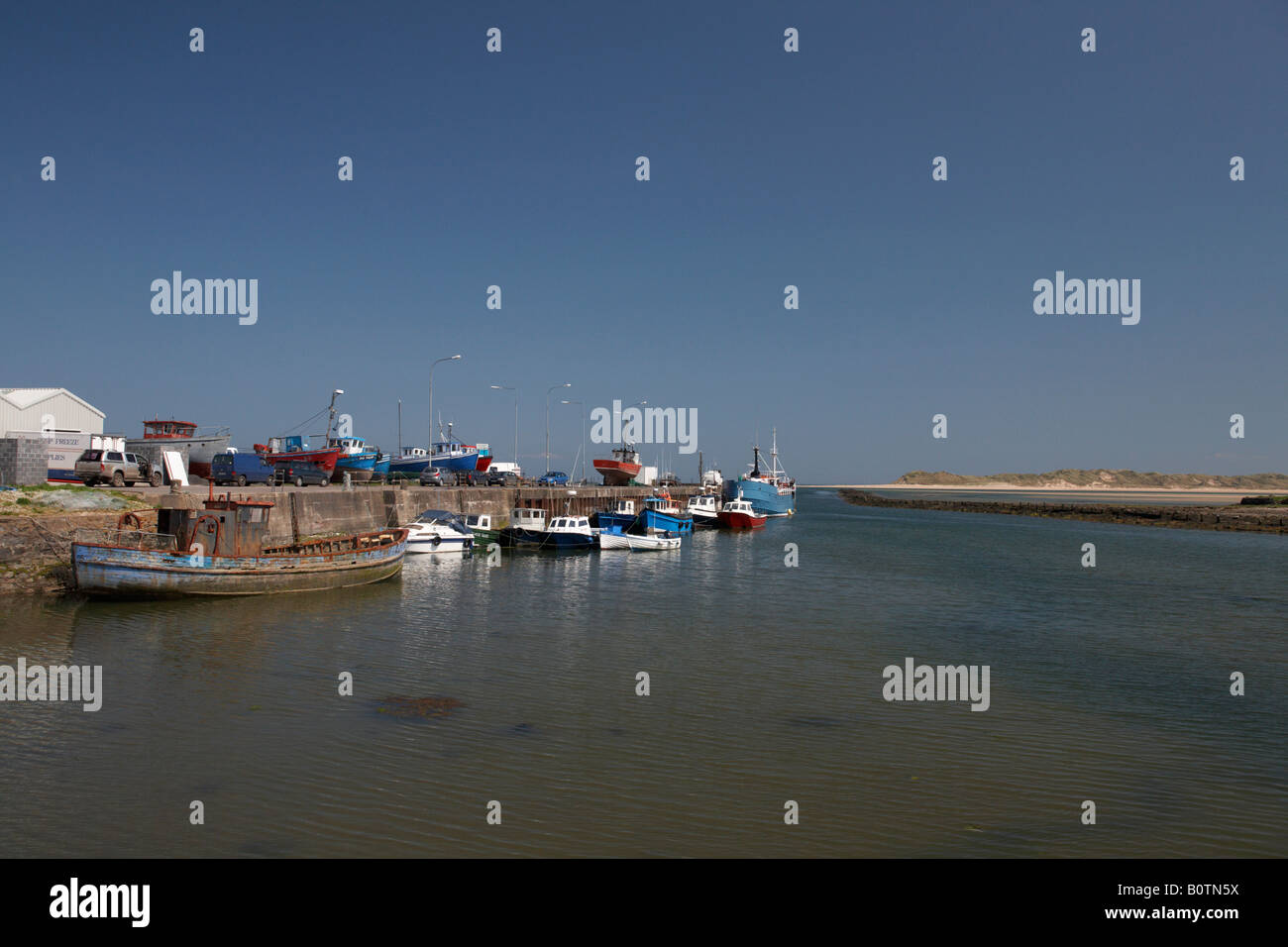 fishing boats at the working killala pier with killala bay in the background county mayo republic of ireland - Stock Image