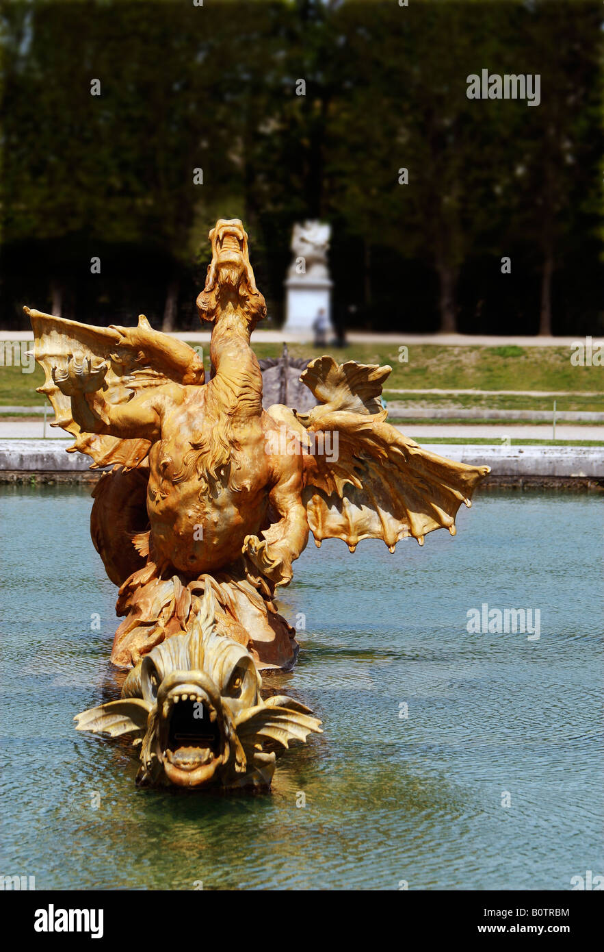 The winged Dragon fountain in the gardens of Versailles Paris France - Stock Image