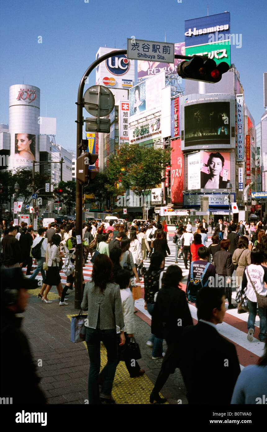 People cross what is reportedly the world's busiest scramble crossing in central Tokyo's Shibuya in Japan. - Stock Image