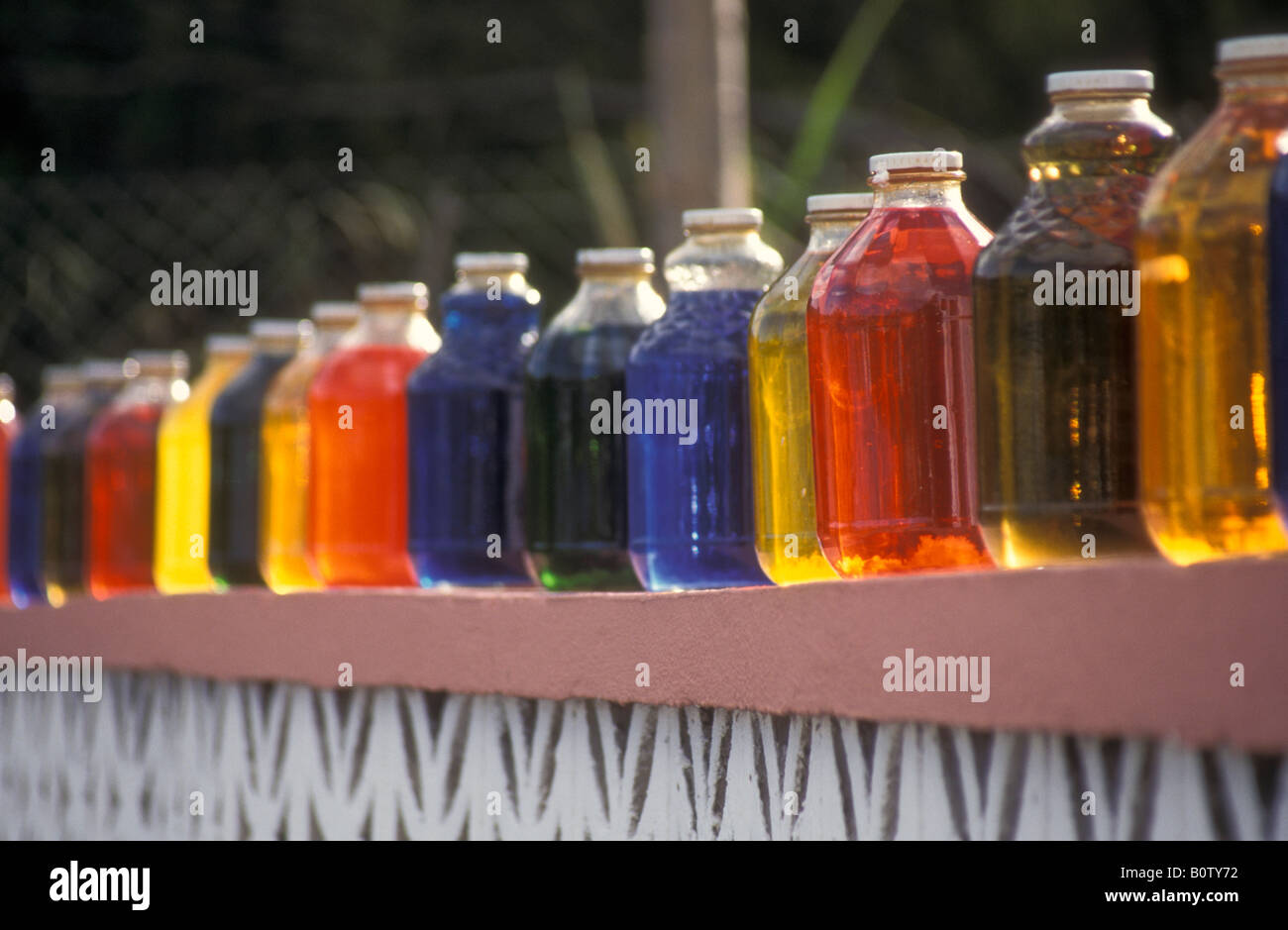Wall Decoration Of Colored Liquid Filled Bottles Mullet Bay