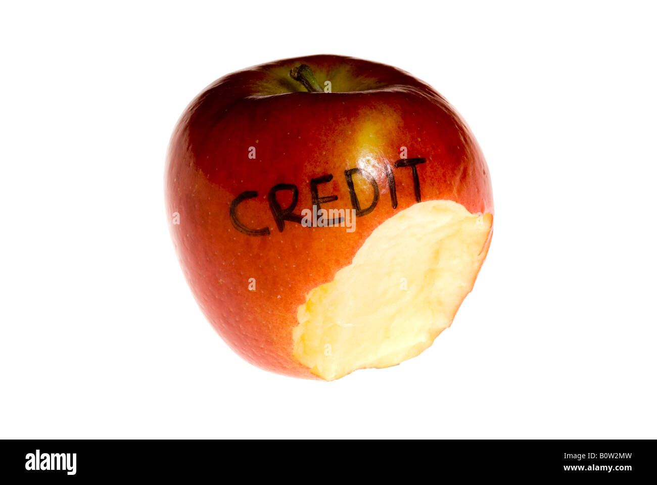An apple with a large bite out of it and the words credit  written on it. Stock Photo