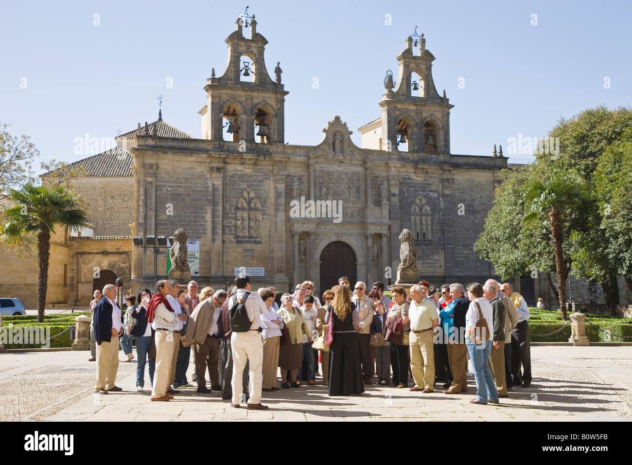 Ubeda Jaen Province Spain Tourist group and guide in front of Iglesia de Santa Maria de los Alcázares - Stock Image