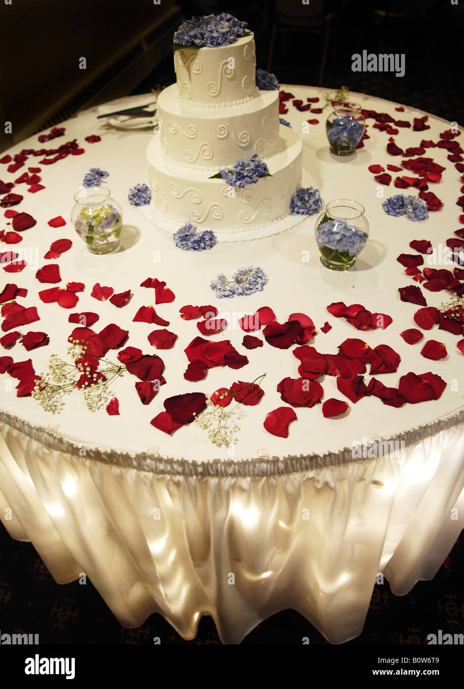 wedding cake with rose petals wedding cake on table at reception surrounded by 26958