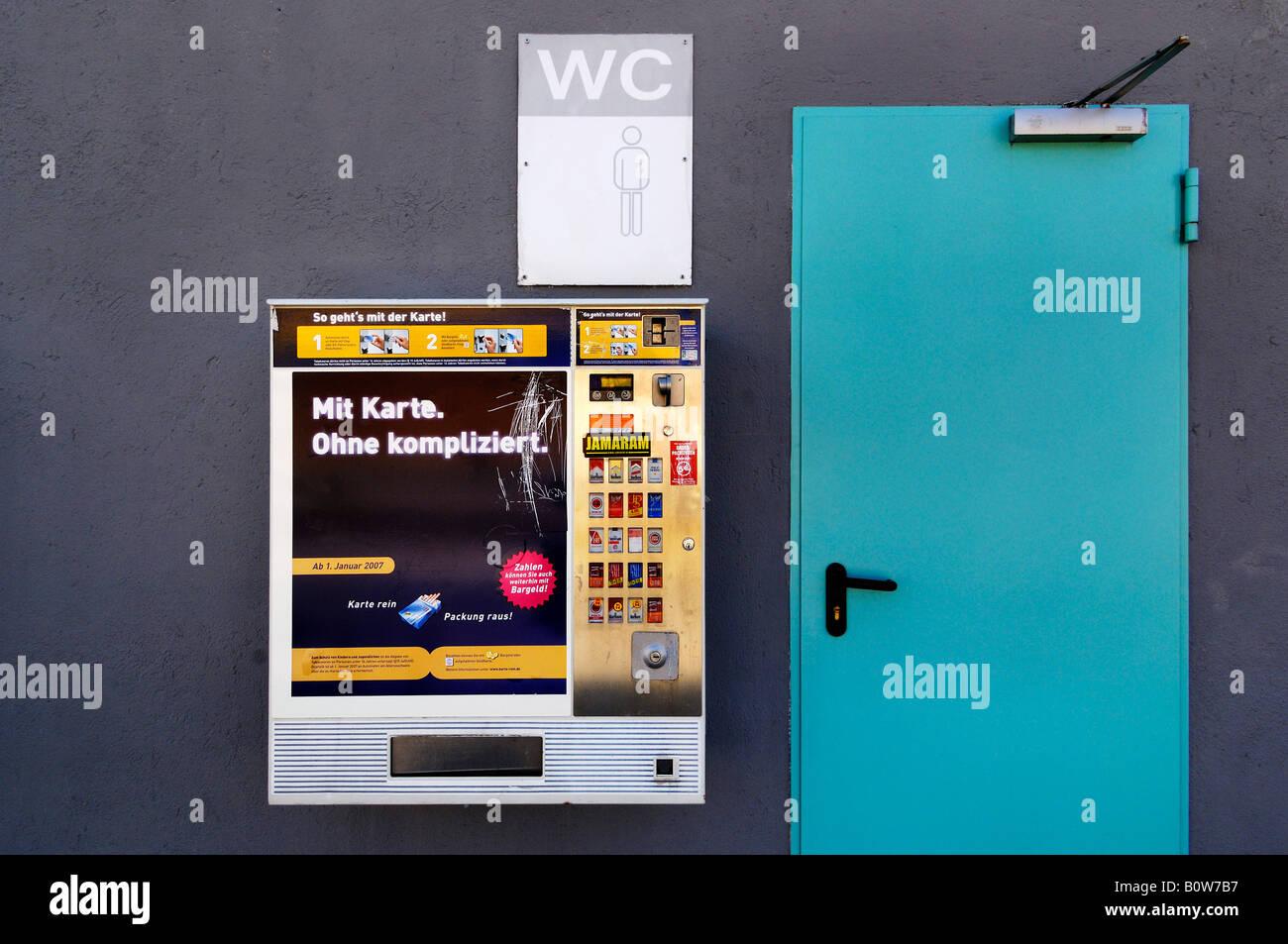 Cigarette vending machine outside a public toilet, Germany Stock Photo