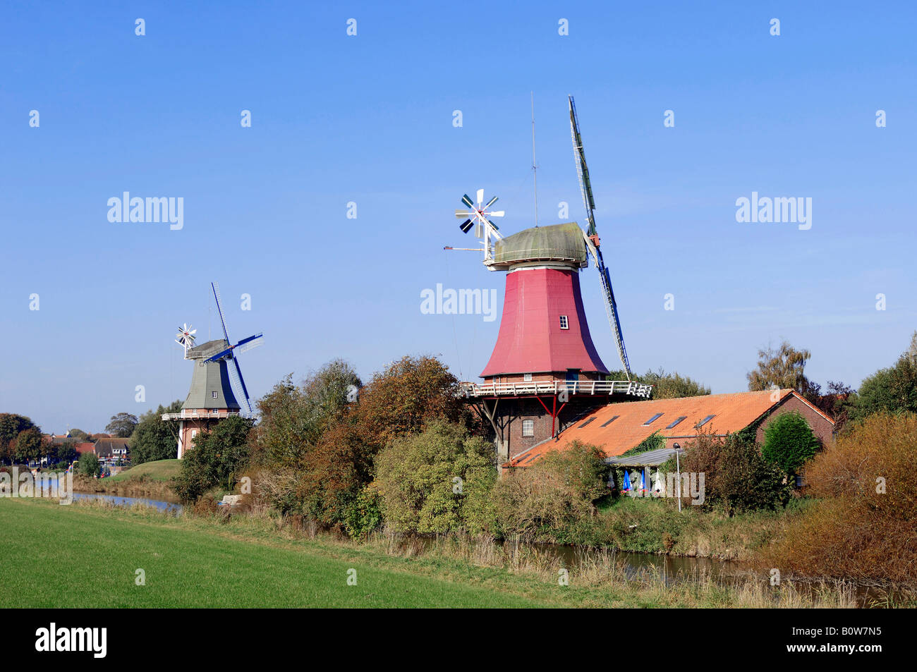Windmills, twin windmills, Greetsiel, East Frisia, Lower Saxony, Germany, Europe - Stock Image