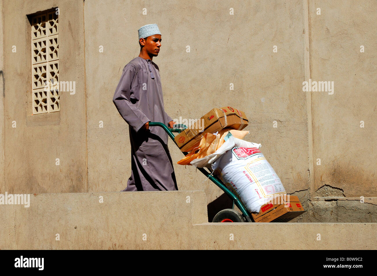 Manual transport of goods to a souk, Nizwa, Oman, Middle East - Stock Image