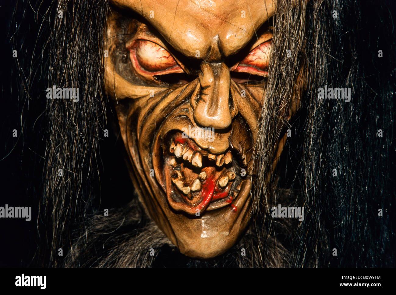 Krampus or devil mask, carved wooden mask - Stock Image