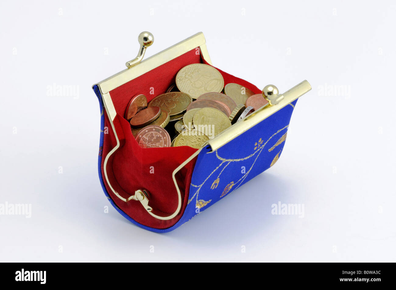 Blue and red Asian style change purse filled with Euro coins - Stock Image