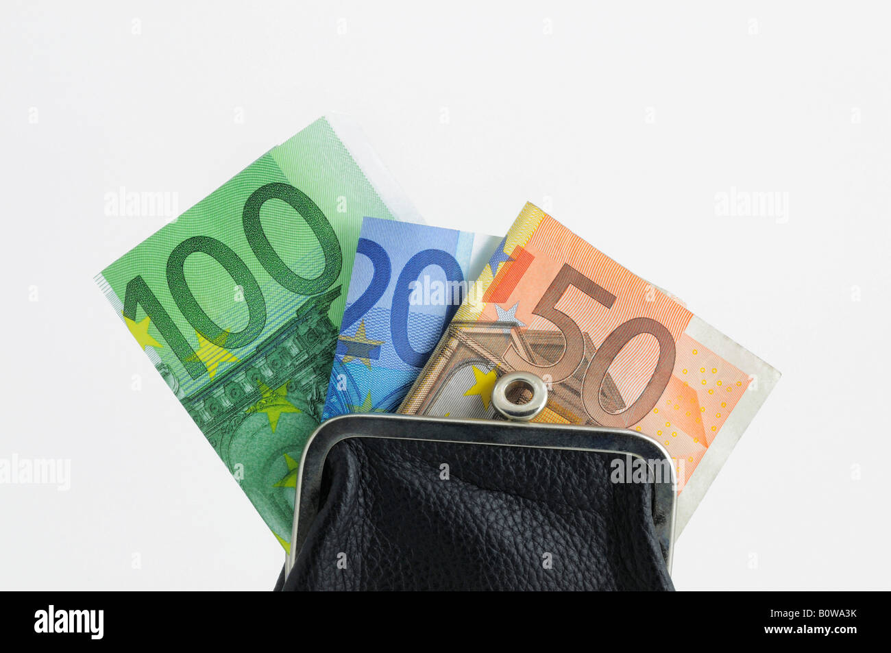 Red change purse filled with Euro banknotes, bills, cash - Stock Image