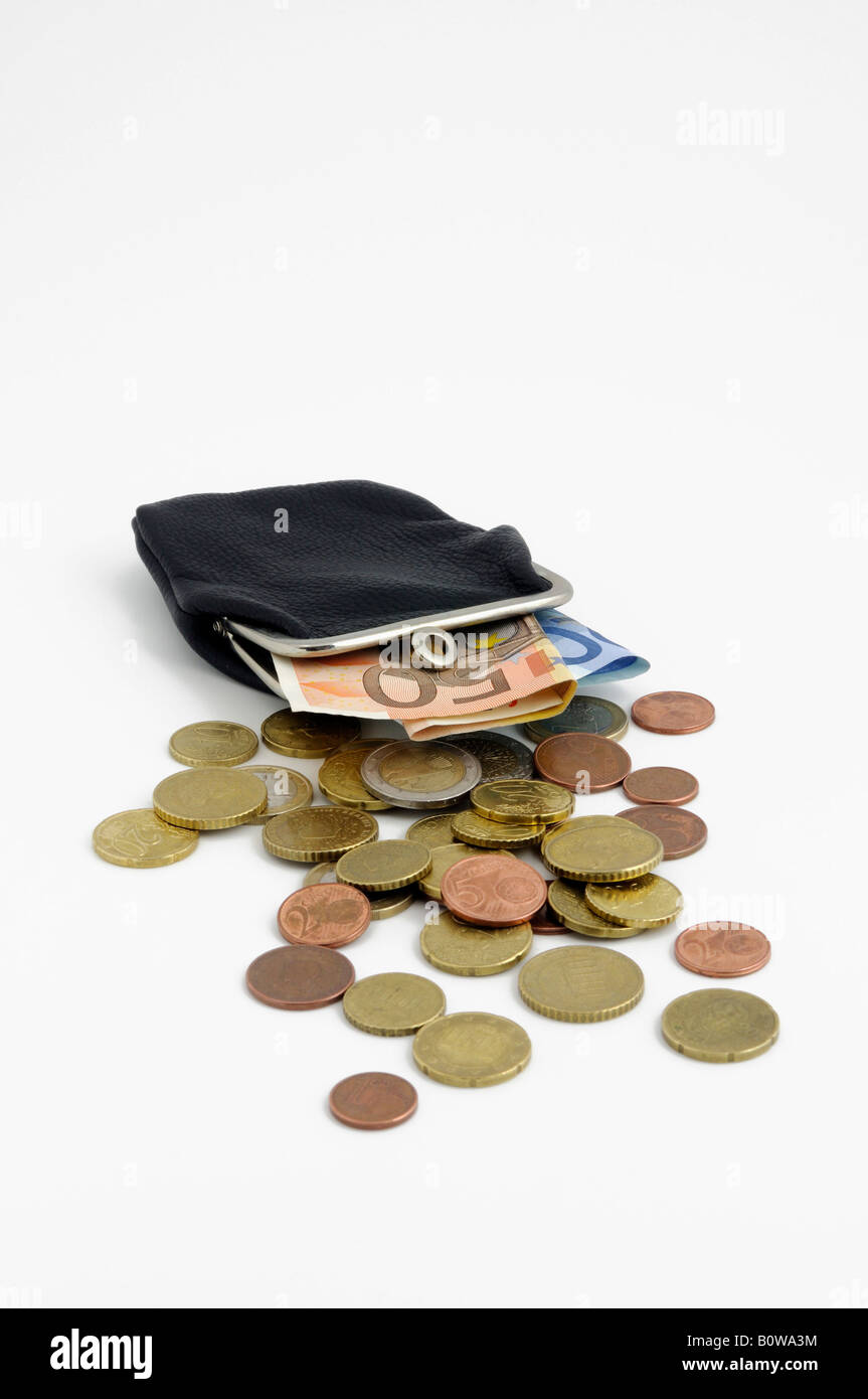 Leather change purse filled with Euro coins and banknotes, bills - Stock Image