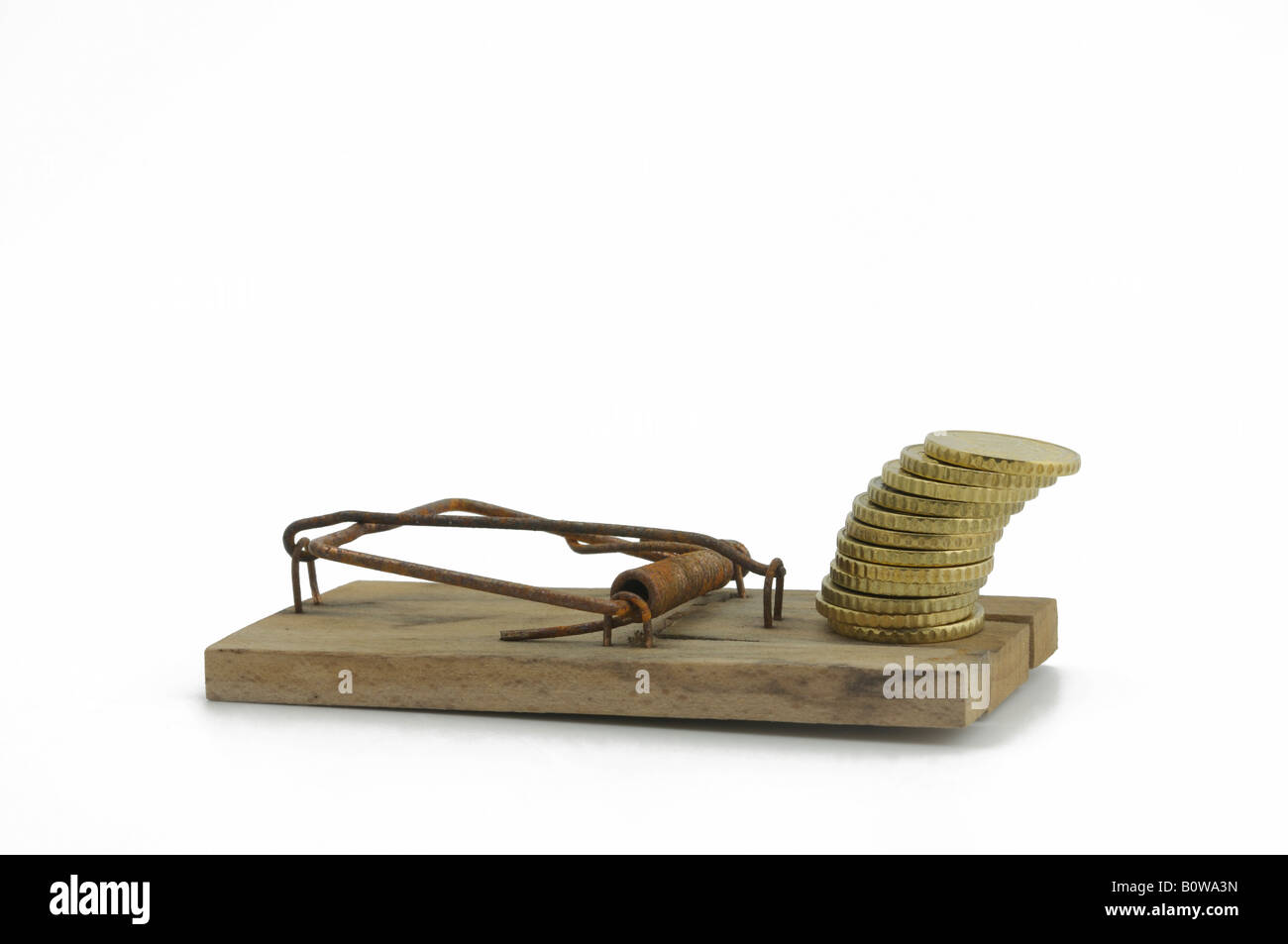 Set mousetrap with a stack of coins as bait - Stock Image